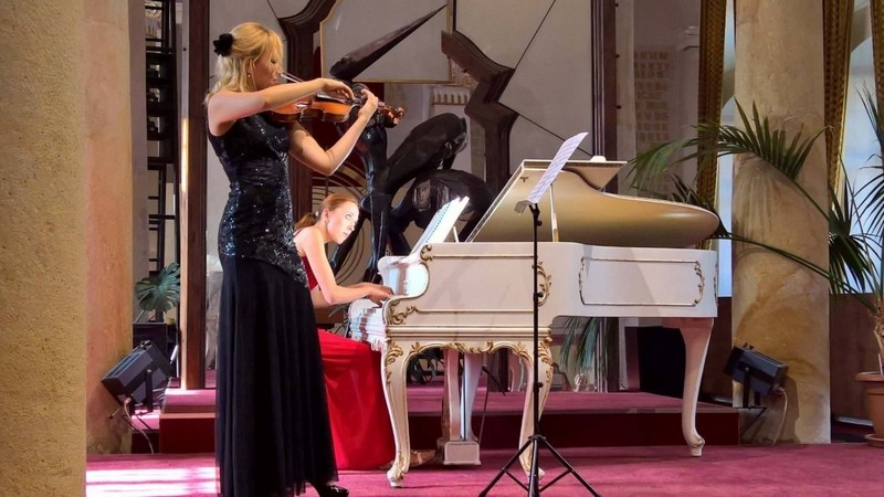Pianist and violinist performing together