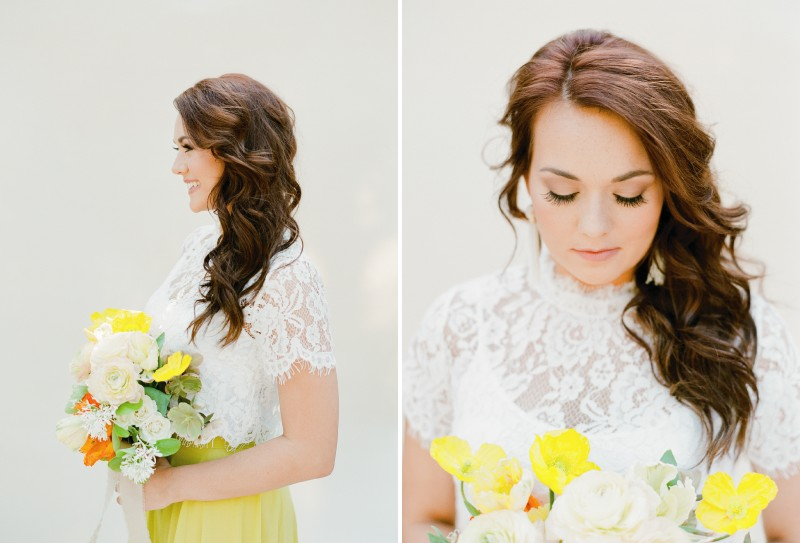 Bridesmaid with loose curl hairstyle holding bouquet with yellow flowers