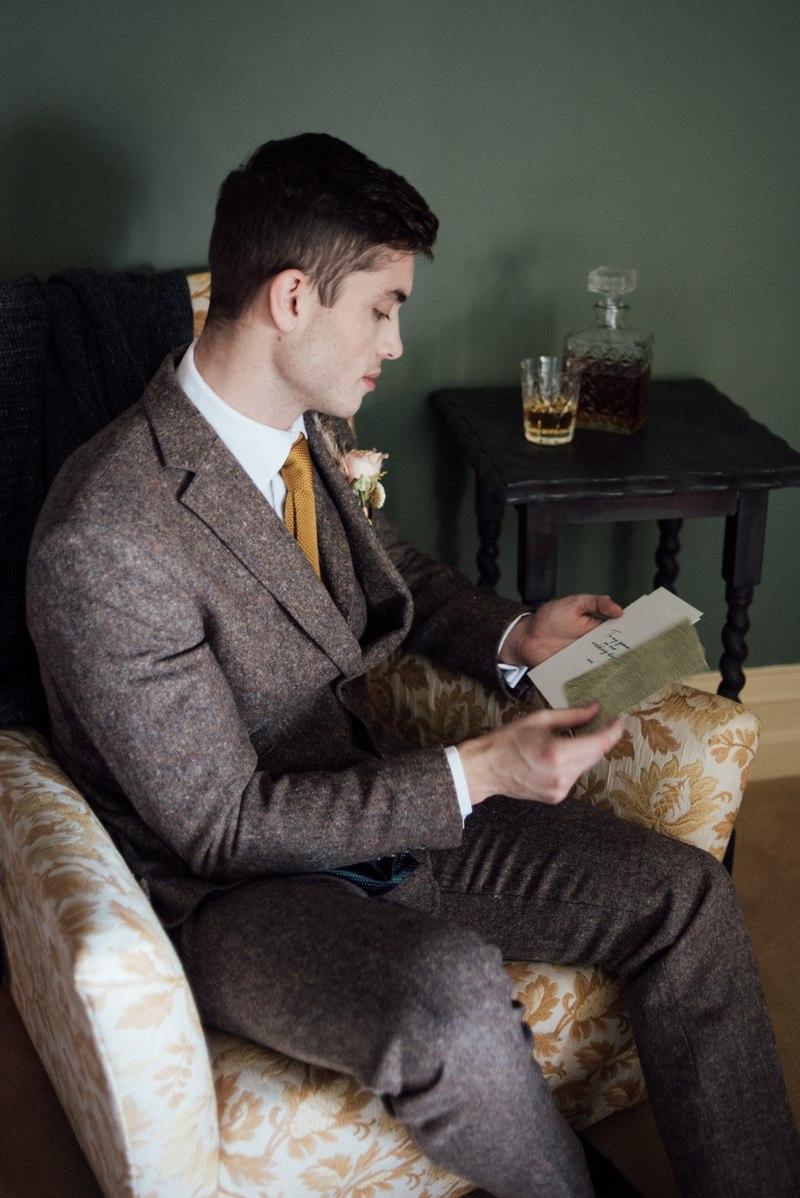 Groom reading wedding day love letter