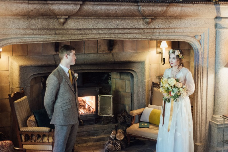 Bride and groom by fireplace at Coombe Trenchard for elopement