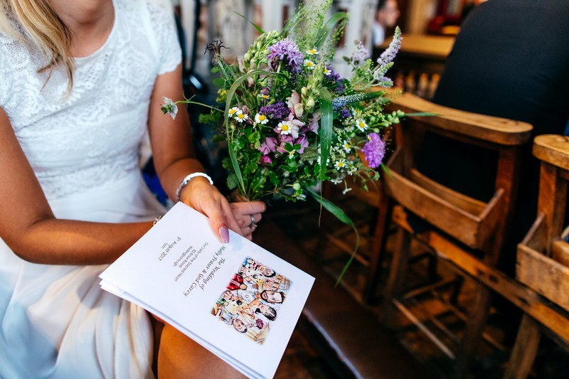 Bridesmaid holding bouquet and order of service