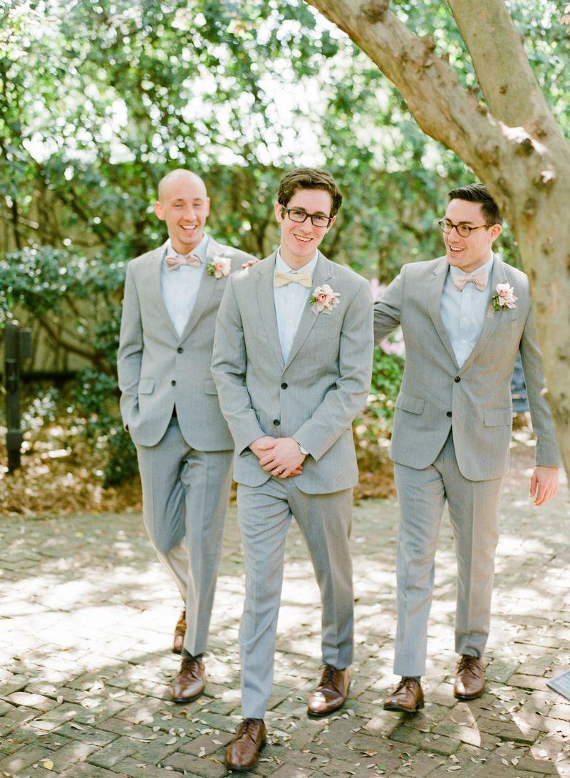 Groomsmen wearing light grey suits