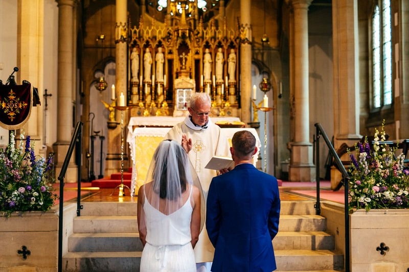 Vicar conducting wedding ceremony