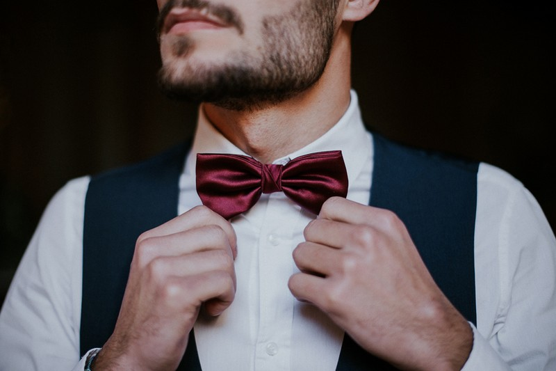 Groom's red bow tie