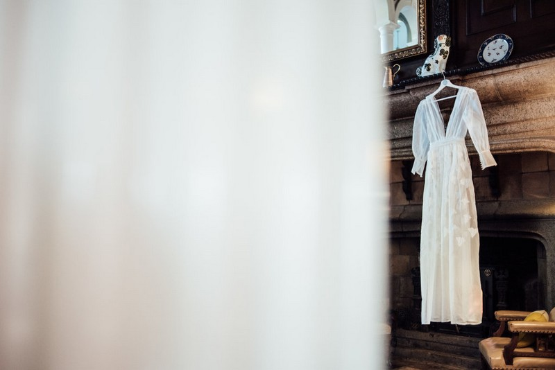 Wedding dress hanging on fireplace
