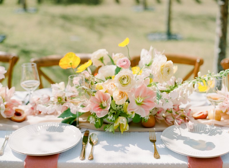 Yellow and peach floral wedding table centrepiece