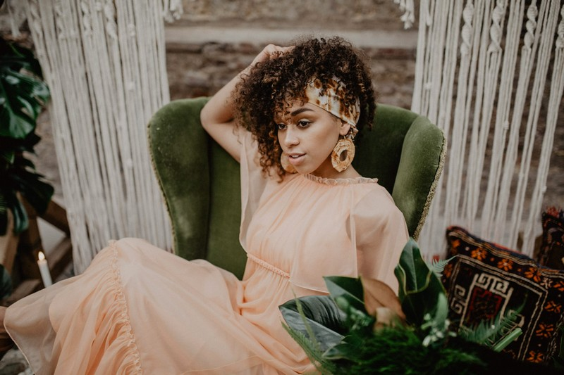 Bride wearing peach wedding dress