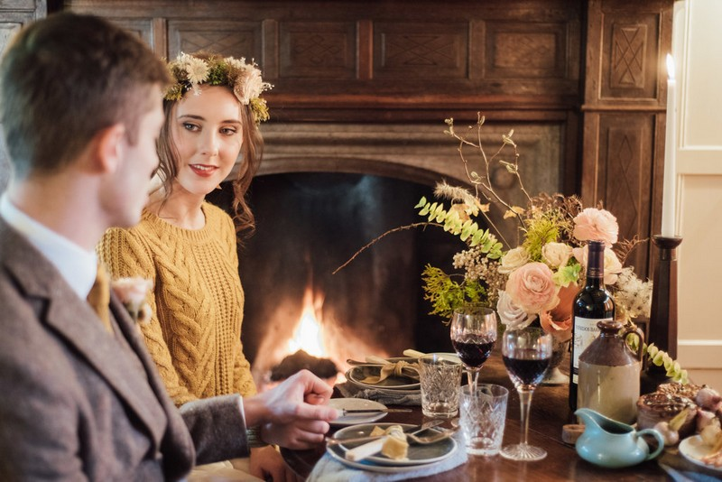 Bride and groom sitting for cosy elopement meal