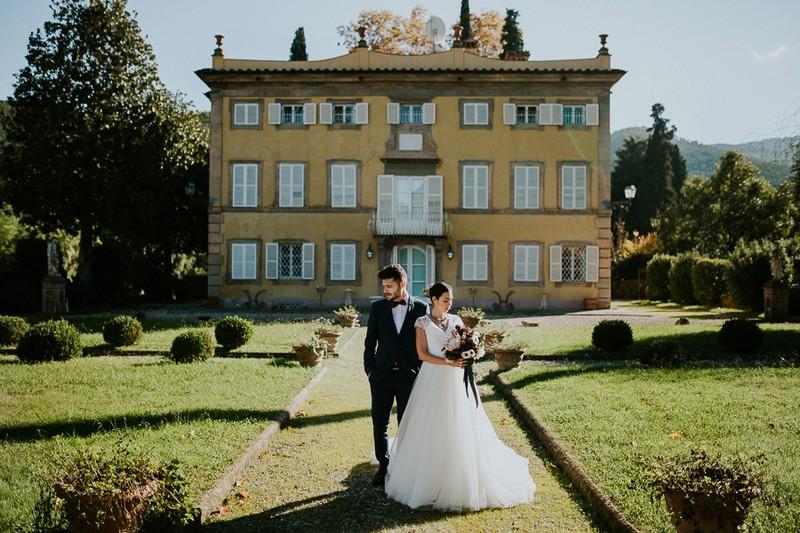 Bride and groom on path outside Villa Lenka, Tuscany