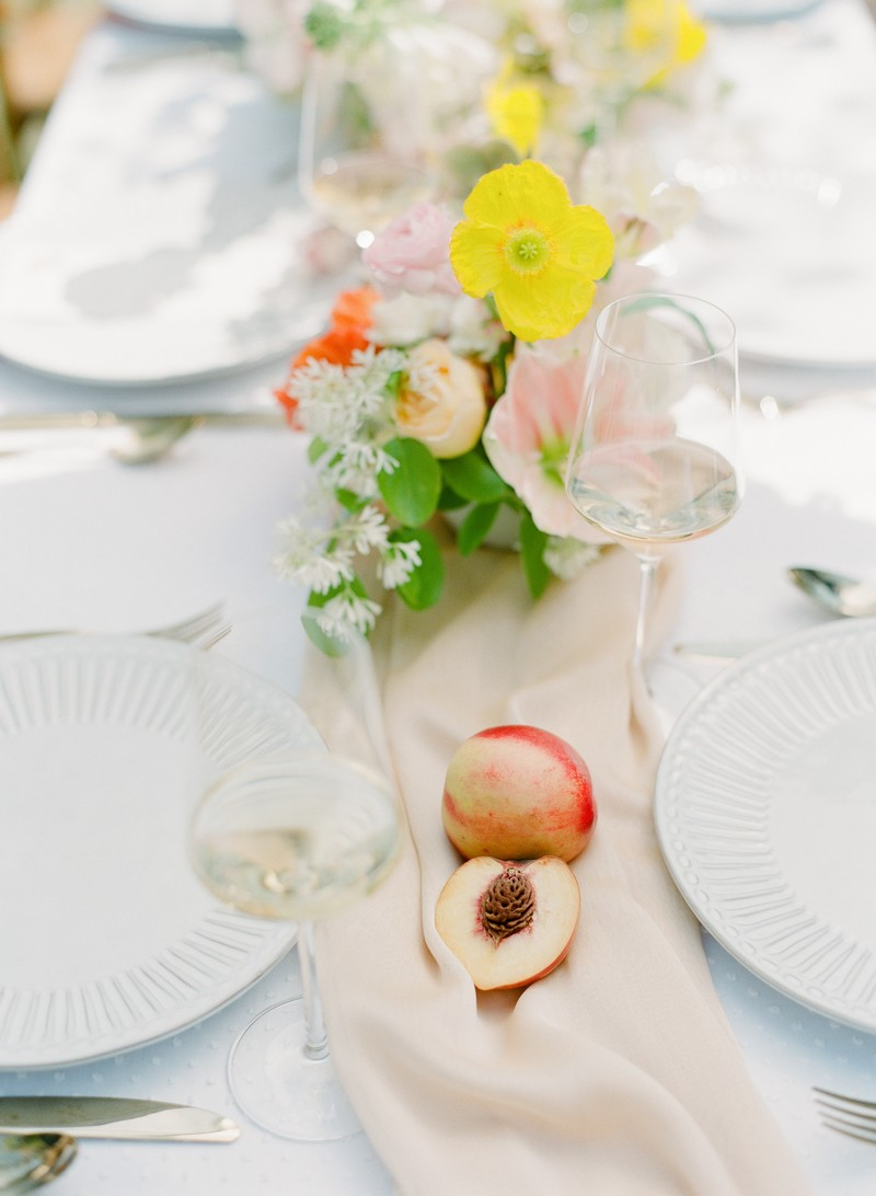 Wedding table runner with yellow flowers and peach