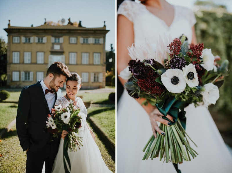 Bride holding winter bouquet with red flowers and white anemones