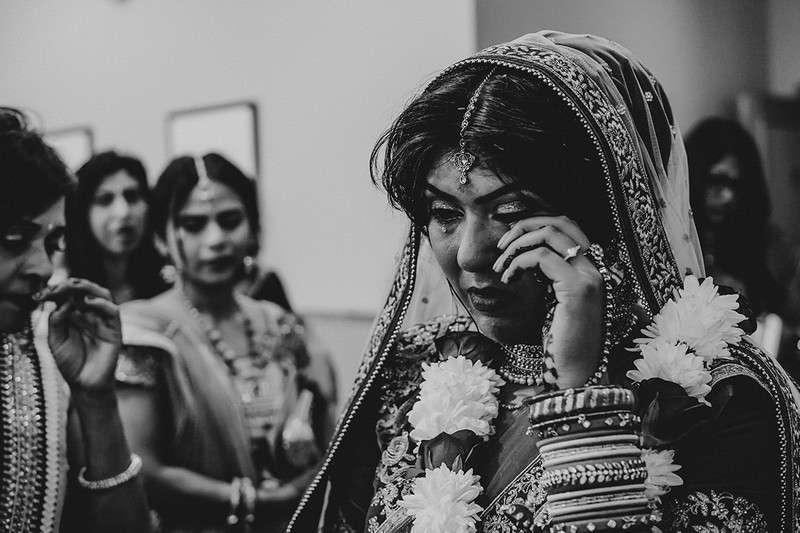 Indian bride wiping away tear - Picture by Embee Photography