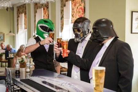 Groomsmen at bar wearing Power Ranger and Star Wars masks - Picture by Penny Young Photography
