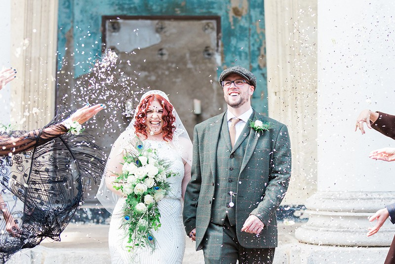 Peaky Bliners bride and groom walking through confetti shower - Picture by James and Kerrie Photography