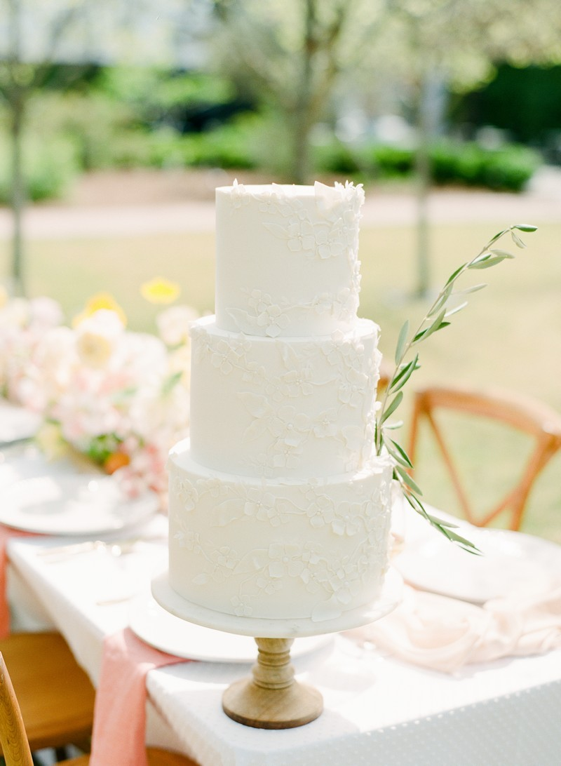 White wedding cake with sprig of Rosemary