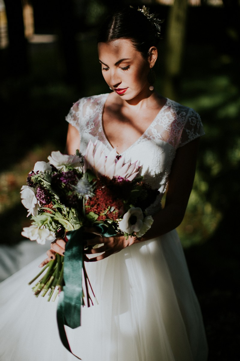 Bride holding winter bouquet