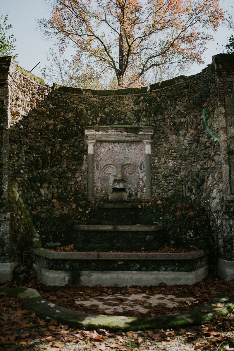 Stone carving of face in monument