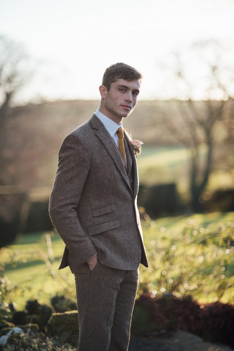 Groom wearing tweed suit