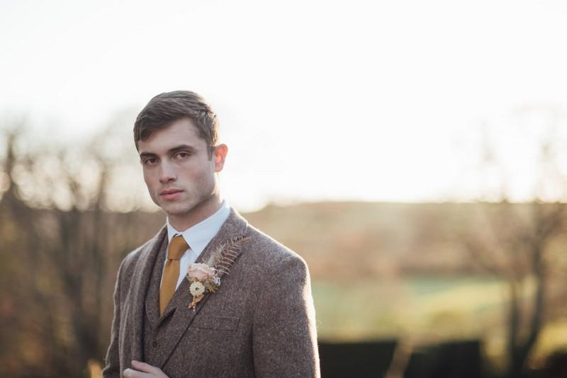 Groom wearing tweed jacket with mustard tie