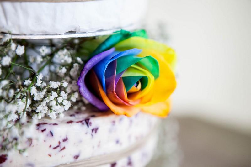 Multicoloured rose on cheese wedding cake