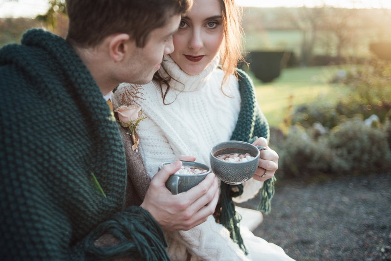 Bride and groom drinking hot chocolate