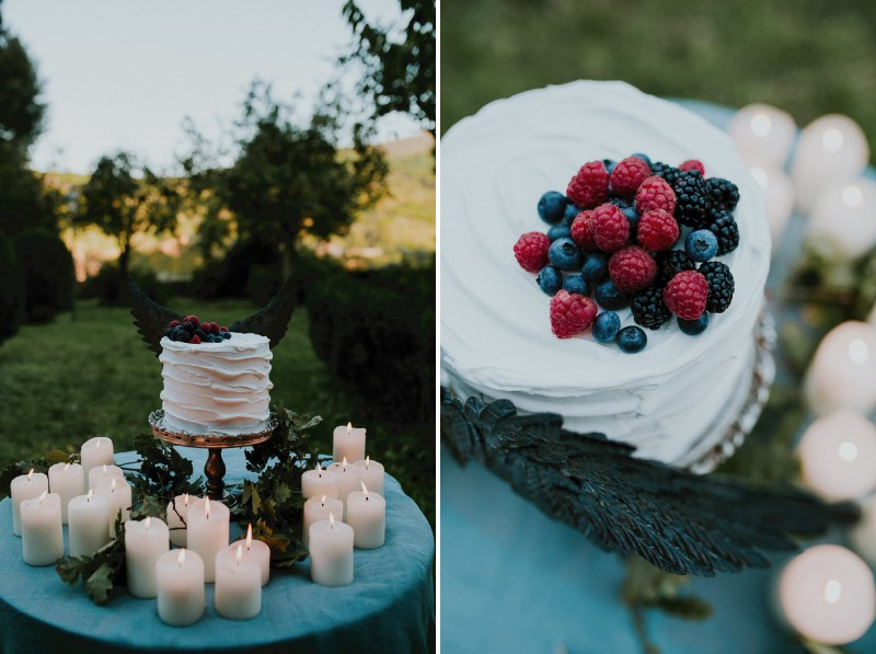Simple white wedding cake with red and blue berries