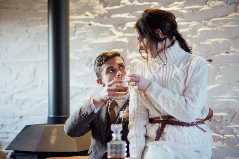 Bride and groom drinking brandy