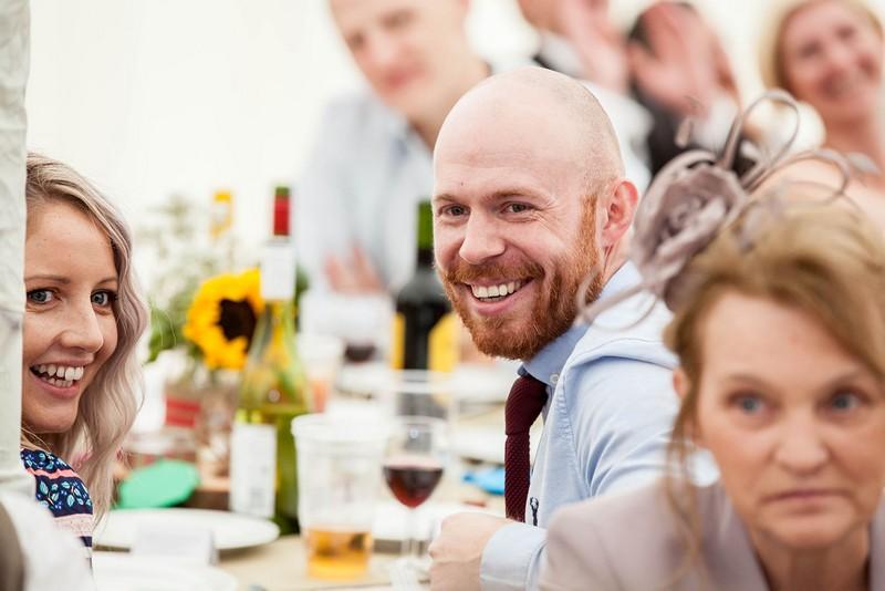 Guest smiling during wedding speech