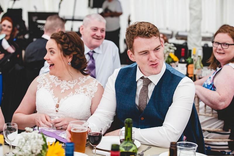 Bride and groom's reactions to wedding speech