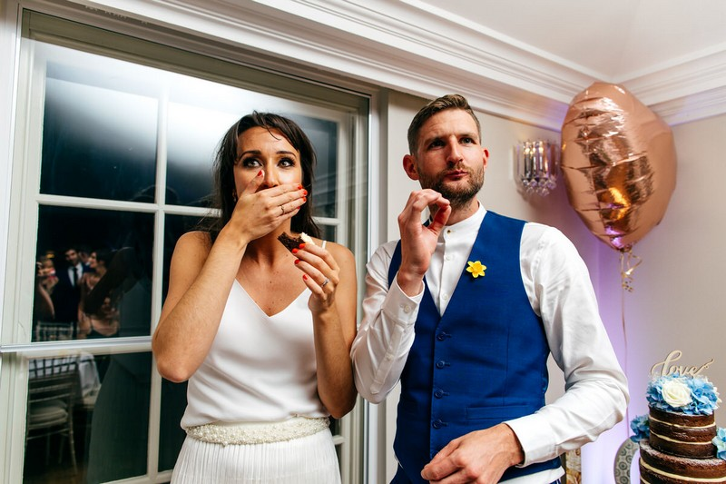 Bride and groom eating wedding cake