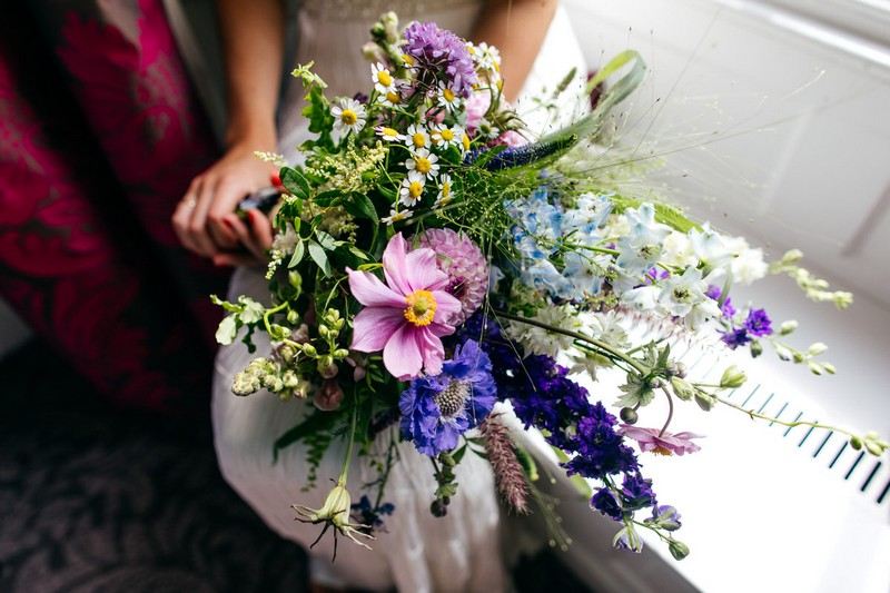 Bride holding wedding bouquet with foxgloves