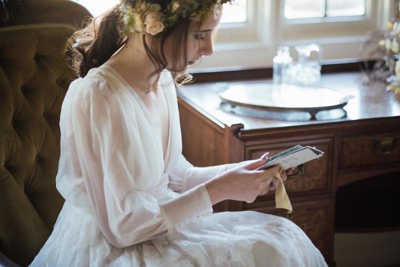 Bride reading wedding day love letter