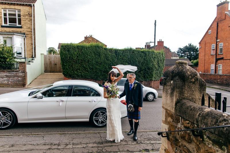 Father walking bride into church