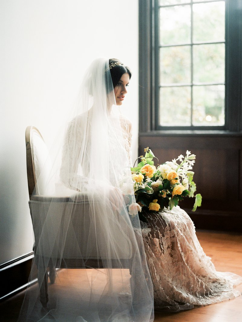 Bride Wearing Veil Sitting in Chair