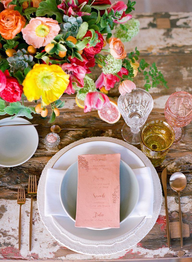 Wedding place setting with colourful flowers
