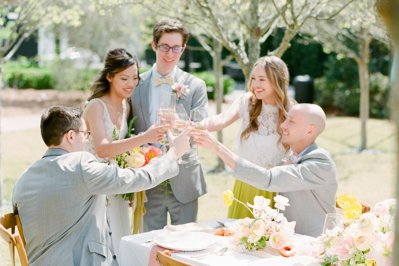 Bridal party toasting at outdoor wedding table