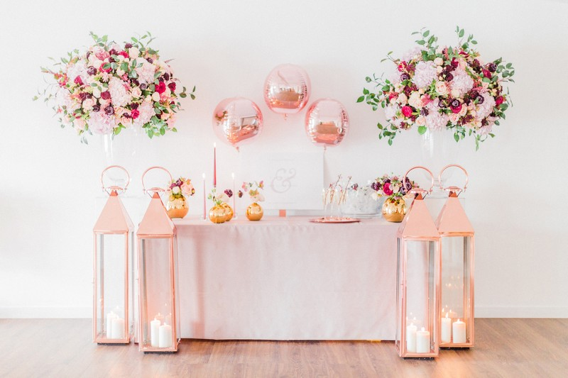 Engagement party welcome table styled with pink and metallic items