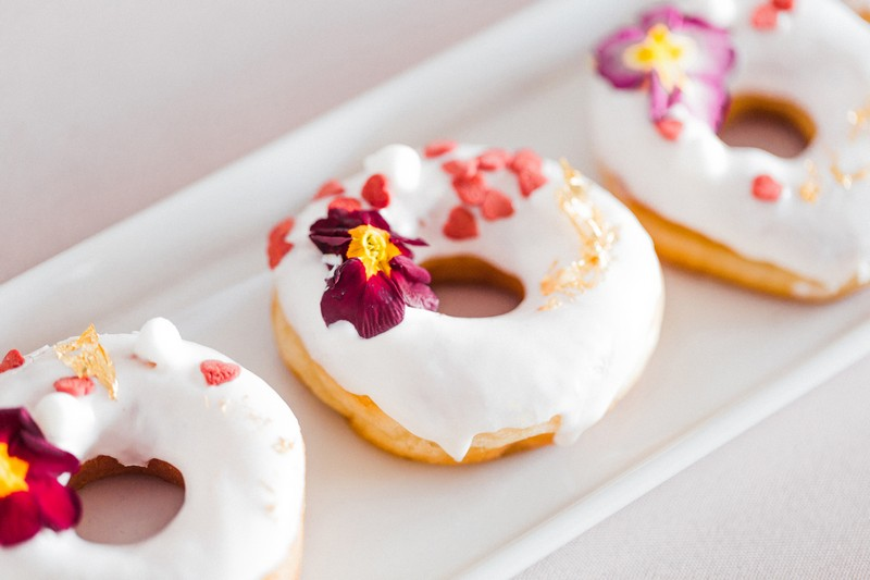 Iced doughnuts with edible flowers