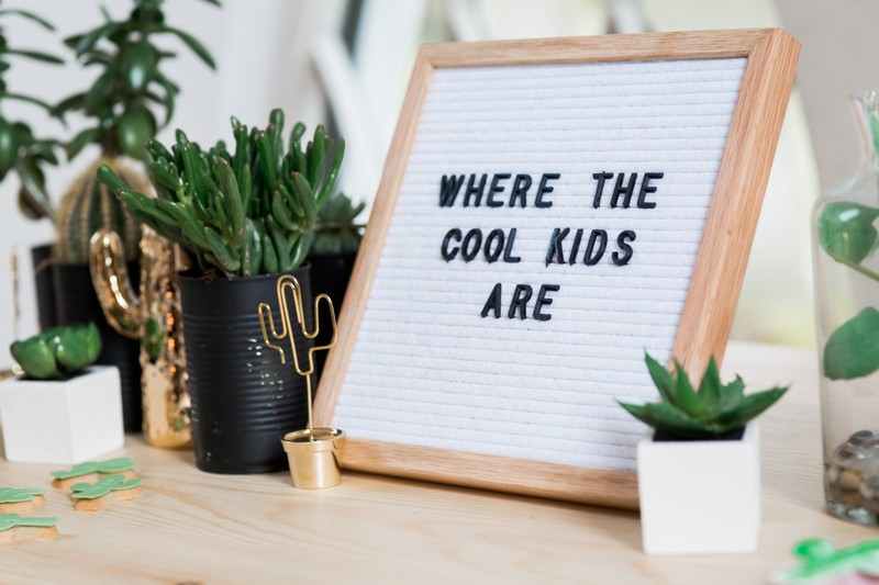 'Where the Cool Kids Are' sign