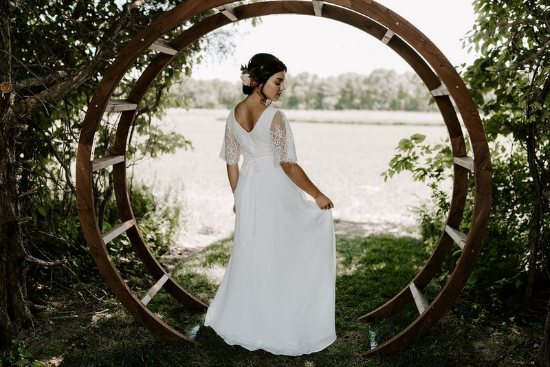 Bride standing in waterwheel