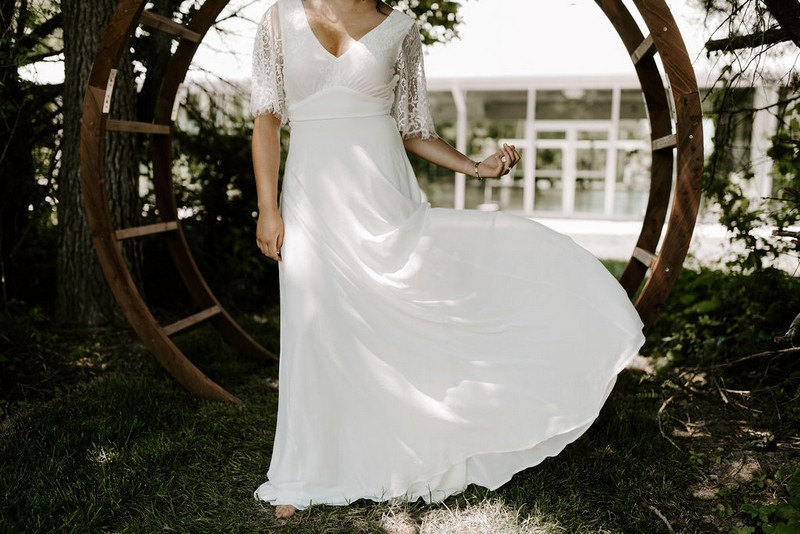 Bride pulling out skirt of wedding dress