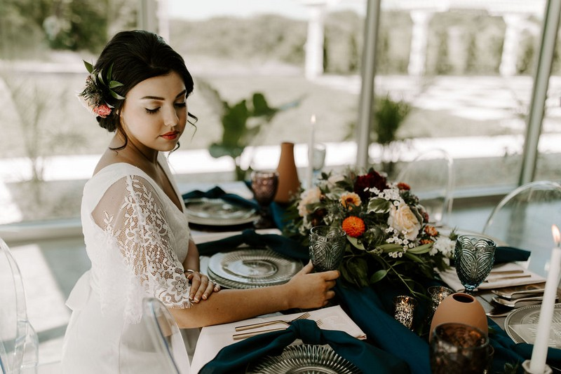 Bride sitting at wedding table