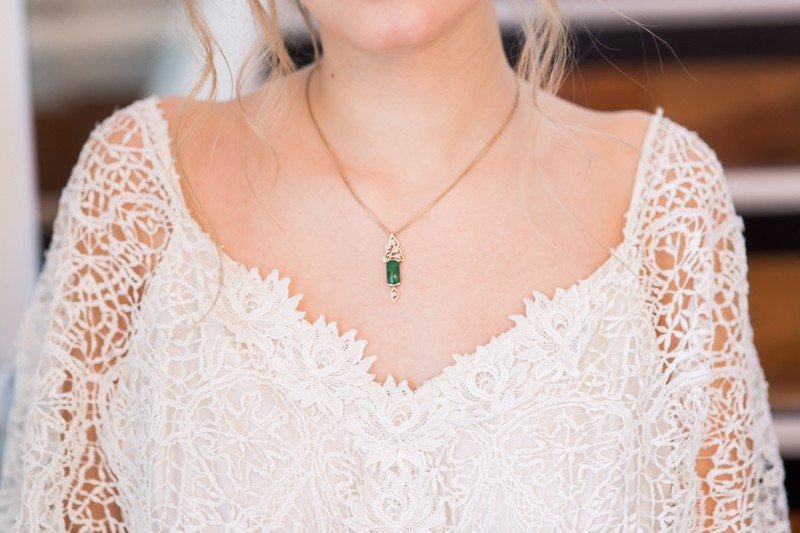 Green pendant on bridal necklace