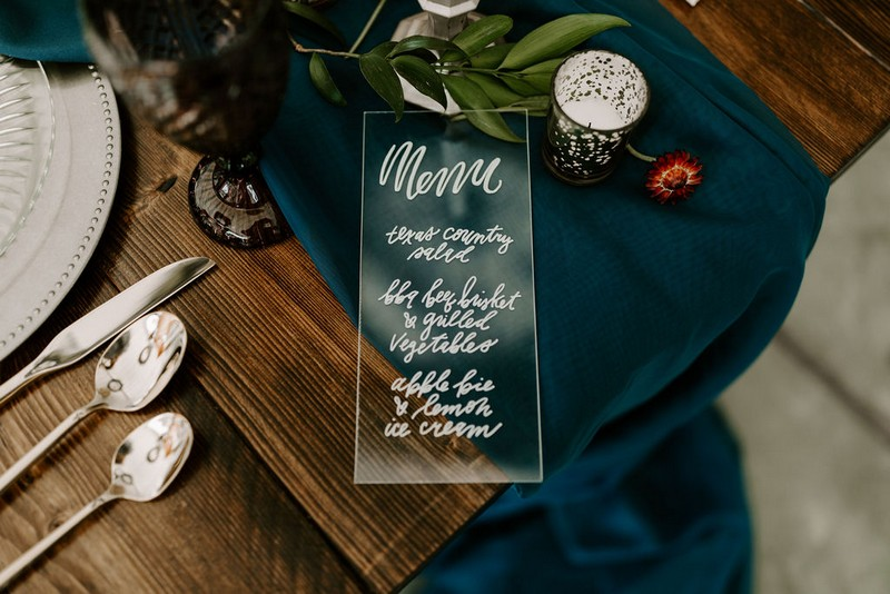 Wedding menu written on glass