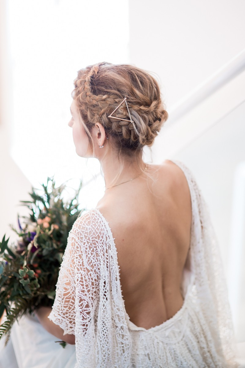 Bride with plait updo and open back wedding dress