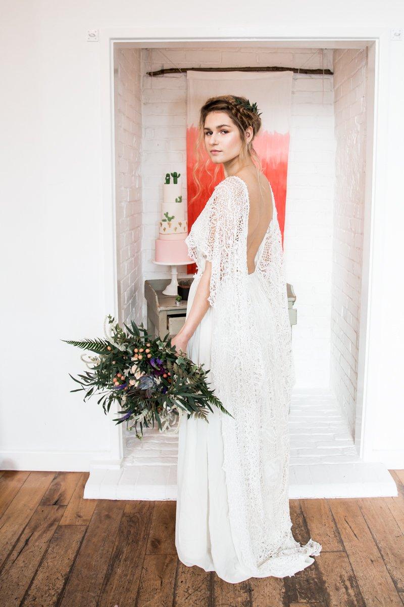 Bride wearing long open back wedding dress