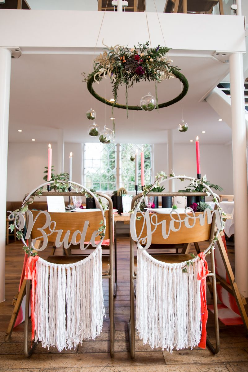 Wedding table with dreamcatcher-inspired backed wedding chairs