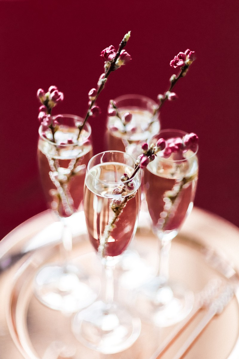 Glasses of champagne with sprigs of cherry blossom