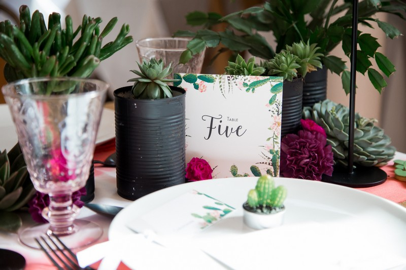 Pots of cacti, succulents and cactus wedding table number