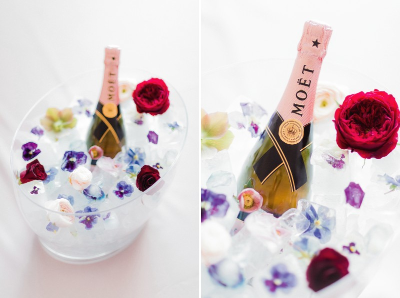 Ice bucket with flowers and bottle of Moët